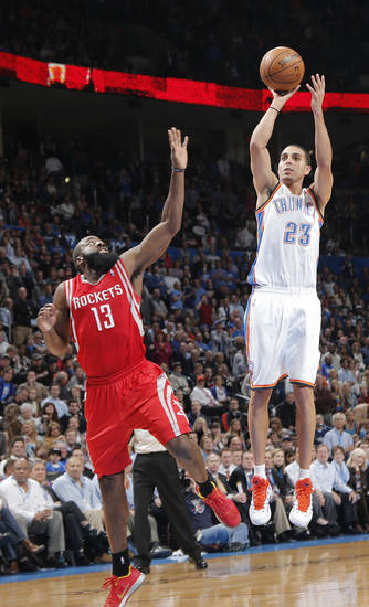 Oklahoma City 's Kevin Martin (23) shoots over Houston's James Harden (13) during the NBA basketball game between the Houston Rockets and the Oklahoma City Thunder at the Chesapeake Energy Arena on Wednesday, Nov. 28, 2012, in Oklahoma City, Okla.   Photo by Chris Landsberger, The Oklahoman