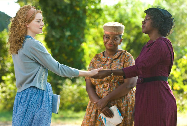 "File - In this undated file film publicity image released by Disney, from left, Emma Stone, Octavia Spencer and Viola Davis are shown in a scene from ""The Help."" ""The Help"" continues to clean up at the box office, taking over the No. 1 spot with $20.5 million in its second weekend. (AP Photo/Disney, Dale Robinette, File)"