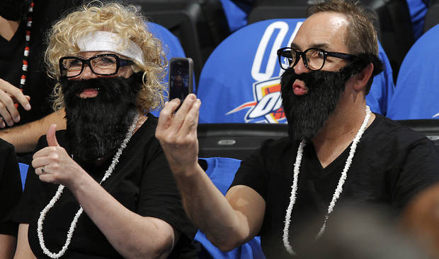 Thunder fans wear their beards during Game 1 of the NBA Finals between the Oklahoma City Thunder and the Miami Heat at Chesapeake Energy Arena in Oklahoma City, Tuesday, June 12, 2012. Photo by Chris Landsberger, The Oklahoman