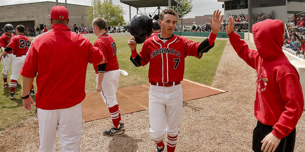 Verdigris's Ryan Skalnik (7) is greeted with a high five as he returns to the dugout after scoring a run during the 3A baseball semifinal game between Verdigris and Spiro on Friday, May 10, 2013, in Edmond, Okla.Photo by Chris Landsberger, The Oklahoman