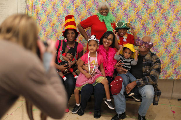 A family gets their picture taken at a photo booth during the Oklahoma City Museum of Art's Family Day on Saturday, April 13, 2013. Photo by Bryan Terry, The Oklahoman
