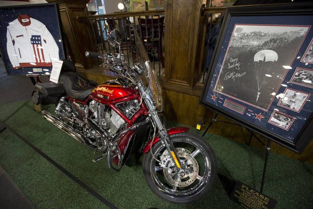 "This Monday, Nov. 26, 2012 photo shows the Harley motorcycle that Evel Knievel rode in his personal life as it sits in a private auto museum in North Palm Beach, Fla. John Staluppi has spent a lifetime selling cars, so successful in his trade he boasts more than two dozen dealerships and more sales than he ever could count. But even he has never seen a sale like this. Staluppi is liquidating his Cars of Dreams Museum and its 115 collector vehicles in an auction Saturday. The Batmobile, the Evel Knievel motorcycle, the lines and lines of perfectly shined cars, all of them will be gone. ""I'm starting to get sad,"" he admits. (AP Photo/J Pat Carter)"