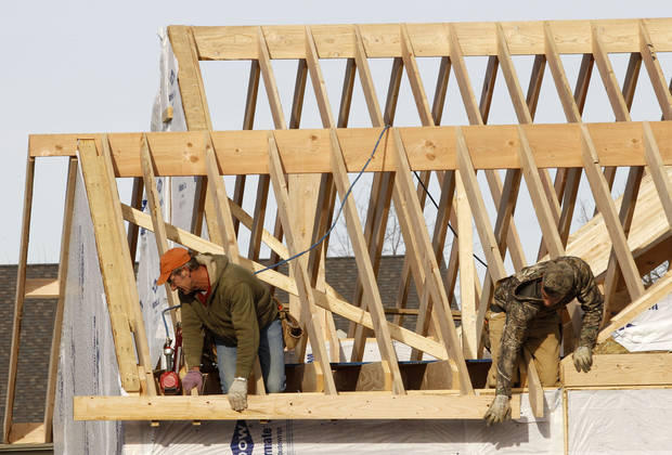 In this Thursday, Dec. 6, 2012, photo a new home is constructed in Pepper Pike, Ohio. US home construction surges 12.1 percent in December to end best year since 2008. (AP Photo/Tony Dejak)