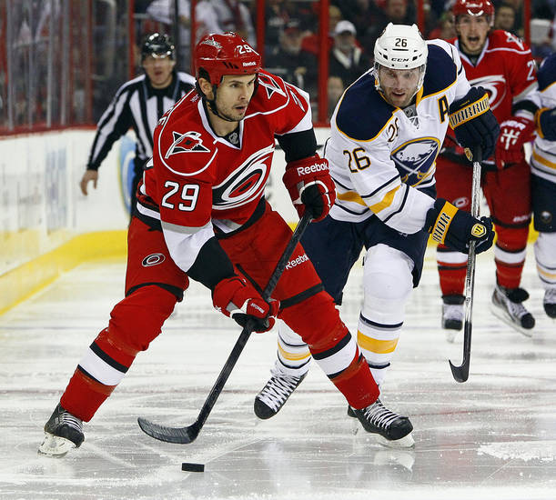 Carolina Hurricanes&#039; Tim Wallace (29) works the puck with Buffalo Sabres&#039; Thomas Vanek (26), of Austria, nearby during the second period of an NHL hockey game, Tuesday, March 5, 2013, in Raleigh, N.C. (AP Photo/Karl B DeBlaker)