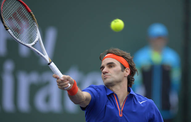 Roger Federer, of Switzerland, returns a shot to Denis Istomin, of Uzbekistan, during their match at the BNP Paribas Open tennis tournament on Saturday, March 9, 2013, in Indian Wells, Calif. (AP Photo/Mark J. Terrill)