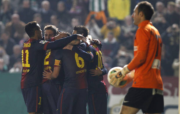 Barcelona's Lionel Messi celebrates with teammates after scoring against Cordoba during the 1st leg of a last-16 Copa del Rey soccer match  at Arcangel stadium in, Cordoba, Spain on Wednesday, Dec. 12, 2012. (AP Photo/Angel Fernandez)