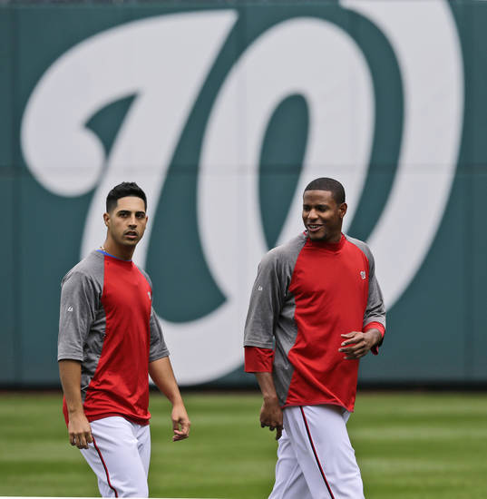 Washington Nationals pitchers Gio Gonzalez, left, and Edwin Jackson walk during batting practice at Nationals Park, Tuesday, Oct. 9, 2012, in Washington. The Nationals host the St. Louis Cardinals in Game 3 of the National League baseball division series Wednesday. The best-of-five series is tied 1-1. (AP Photo/Alex Brandon)