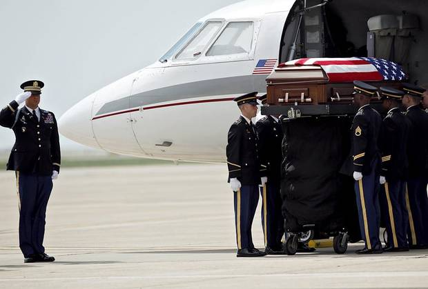 The Honor Guard stands at attention as the casket of 1st Lt. Damon Leehan is unloaded from a plane at the Oklahoma Air National Guard near Will Rogers World Airport in Oklahoma City on Tuesday, Aug. 23, 2011. Photo by John Clanton, The Oklahoman ORG XMIT: KOD