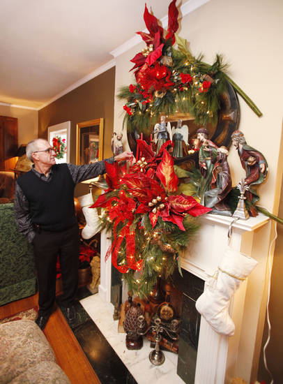 Mike Stuart stands beside the mantel in his home at 1221 N Miller Boulevard in Oklahoma City, OK, Monday, Nov. 21, 2011. It is decorated for the Miller Mantel tour. By Paul Hellstern, The Oklahoman