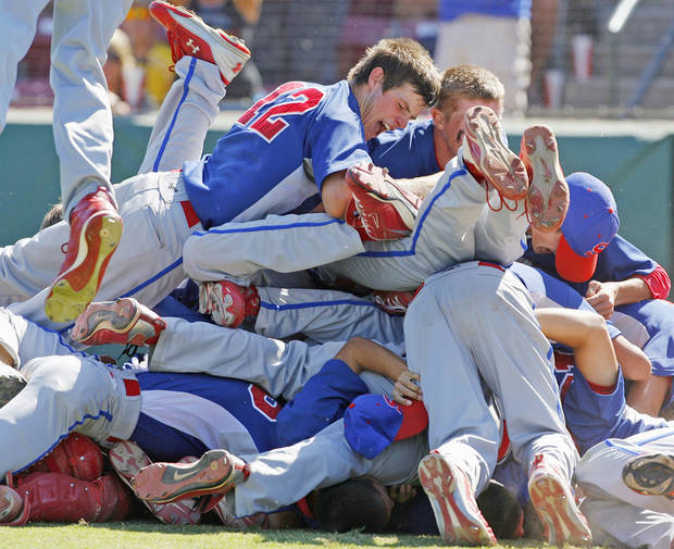Silo players celebrate their state championship win over Okarche during the Fall High School Baseball State Tournament at L. Dale Mitchell Park on Saturday, October 9, 2010, in Norman, Okla.  On top of the pile is pitcher Shawn Hendricks (12).   Photo by Steve Sisney, The Oklahoman