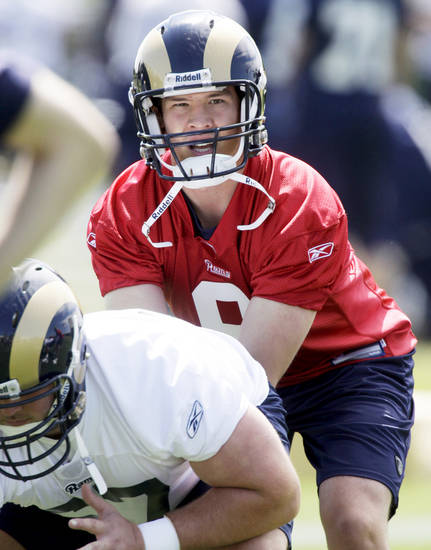 St. Louis quarterback Sam Bradford prepares to take a snap during drills on May 18. AP Photo