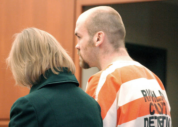 This Feb. 28, 2012 photo shows Michael Spell, right, appearing with public defender Randi Hood at his arraignment on aggravated kidnapping charges in connection with a missing Montana teacher in Sidney, Mont. Spell reportedly came to the Montana region from Colorado seeking work connected to the booming Bakken oil fields. (AP Photo/Matthew Brown)