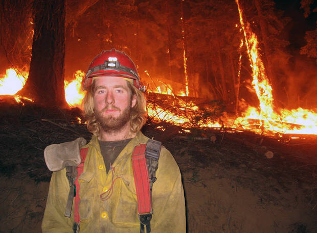 This July 2008 photo provided by John Lauer shows firefighter John Lauer in front of a back burn during a wildfire in Montana. Lauer, who works with the Tatanka Hotshots, posted a petition online this spring urging a change in federal rules to let temporary firefighters buy into the government health plan. While Lauer&Acirc;s crew was fighting a wildfire in Colorado, the petition went viral and mushroomed from 1,000 signatures to more than 90,000 in a matter of days. (AP Photo/Courtesy John Lauer) ORG XMIT: CODE103 &lt;strong&gt;Uncredited - AP&lt;/strong&gt;