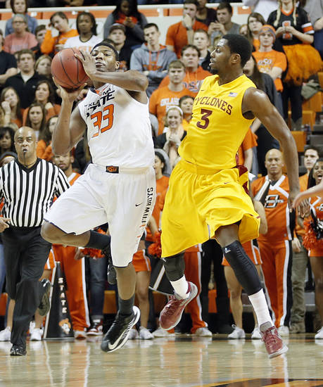Oklahoma State Cowboys&#039; Marcus Smart (33) shoots a shot at the buzzer past mid court over Iowa State Cyclones&#039; Melvin Ejim (3) during the college basketball game between the Oklahoma State University Cowboys (OSU) and the Iowa State University Cyclones (ISU) at Gallagher-Iba Arena on Wednesday, Jan. 30, 2013, in Stillwater, Okla.  Photo by Chris Landsberger, The Oklahoman