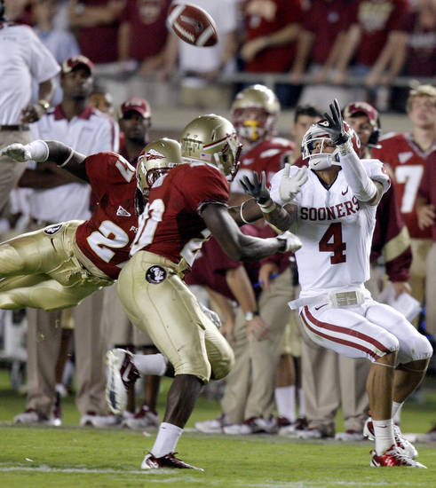 Oklahoma's Kenny Stills (4) catches a pass in front of Florida's Xavier Rhodes (27) and Florida's Lamarcus Joyner (20) during a college football game between the University of Oklahoma (OU) and Florida State (FSU) at Doak Campbell Stadium in Tallahassee, Fla., Saturday, Sept. 17, 2011. Photo by Bryan Terry, The Oklahoman
