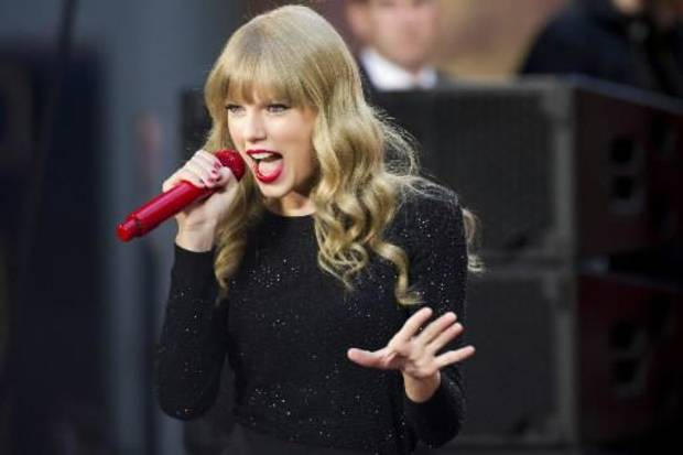 "This Oct. 23, 2012 file photo shows Taylor Swift performing on ABC's ""Good Morning America"" in New York. Swift will co-host The Grammy nominations concert with LL COOL J on Wednesday, Dec. 5, in Nashville, Tenn. (Photo by Charles Sykes/Invision/AP, file)"
