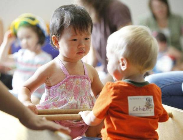 Joy Zhai and Cohen Colwell, both 1, play on a see-saw during Lapsit: Playtime and Story Time. PHOTO BY PAUL HELLSTERN, THE OKLAHOMAN <strong>PAUL HELLSTERN</strong>