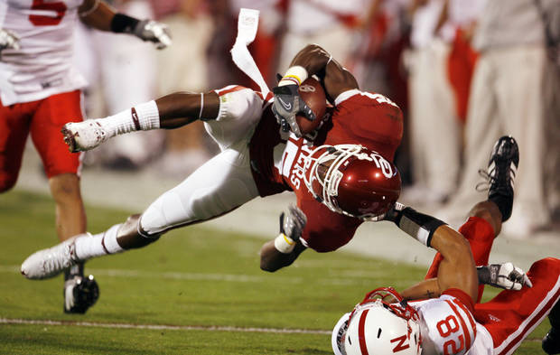 Ran Broyles is brought down by Eric Hagg during the first half of the college football game between the University of Oklahoma Sooners (OU) and the University of Nebraska Huskers (NU) at the Gaylord Family Memorial Stadium, on Saturday, Nov. 1, 2008, in Norman, Okla. 