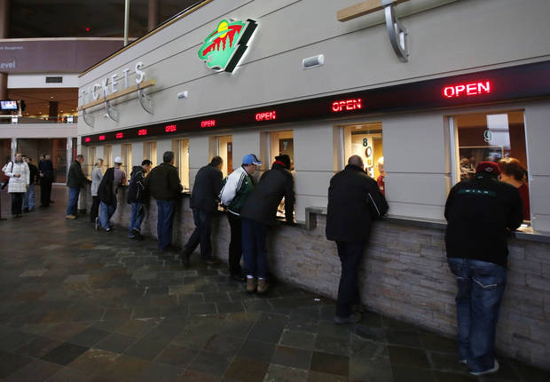 Minnesota Wild NHL hockey fans  fill the ticket windows for single game tickets Wednesday, Jan. 16, 2013, in St. Paul, Minn. The Wild play their home opener Saturday against the Colorado Avalanche. (AP Photo/Jim Mone)