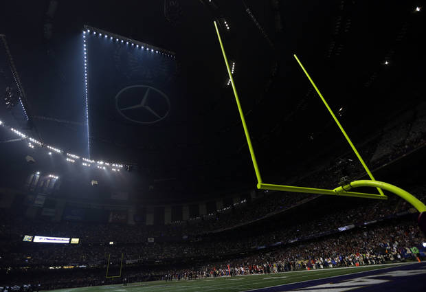 Half the lights are out in the Superdome during a power outage in the second half of the NFL Super Bowl XLVII football game between the San Francisco 49ers and Baltimore Ravens on Sunday, Feb. 3, 2013, in New Orleans. (AP Photo/Marcio Sanchez)