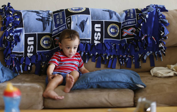 Ethan Fogle, 2 1/2, who is showing signs of autism, sits on a sofa in Moore on  Wednesday. Ethan will attend a special screening at the Moore Warren Theatre for children with autism and other sensory disorders. Photo by Bryan Terry, The Oklahoman <strong>Bryan Terry</strong>