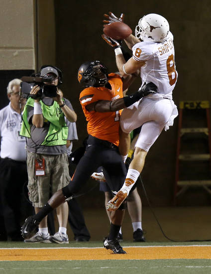 Texas&#039; Jaxon Shipley (8) catches a touchdown pass over Oklahoma State&#039;s Kevin Peterson (1)  during a college football game between Oklahoma State University (OSU) and the University of Texas (UT) at Boone Pickens Stadium in Stillwater, Okla., Saturday, Sept. 29, 2012. Oklahoma State lost 41-36. Photo by Bryan Terry, The Oklahoman