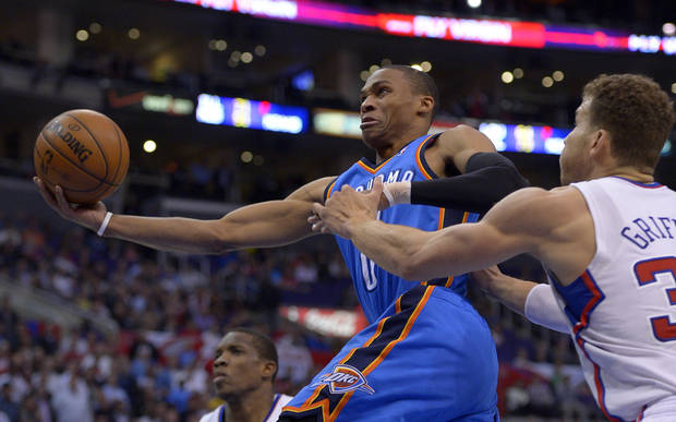 Oklahoma City Thunder guard Russell Westbrook, left, goes up for a shot as Los Angeles Clippers forward Blake Griffin defends during the second half of their NBA basketball game, Tuesday, Jan. 22, 2013, in Los Angeles. The Thunder won 109-97.  (AP Photo/Mark J. Terrill)  ORG XMIT: LAS109