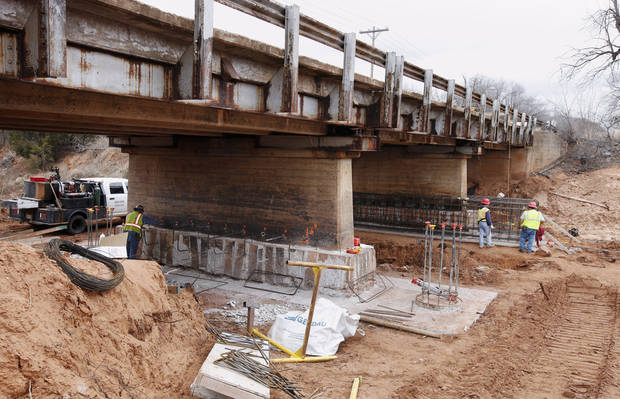 Contractors are replacing four piers on the Sooner Road Bridge. The bridge was closed in September for  emergency repairs. PHOTO BY PAUL B. SOUTHERLAND, THE OKLAHOMAN