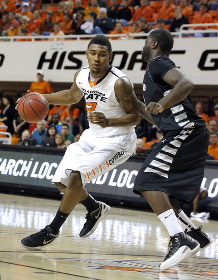 Oklahoma State's Le'Bryan Nash (2) tries to get around Portland State's Renado Parker (30) during the college basketball game between Oklahoma State University and Portland State, Sunday,Nov. 25, 2012. Photo by Sarah Phipps, The Oklahoman