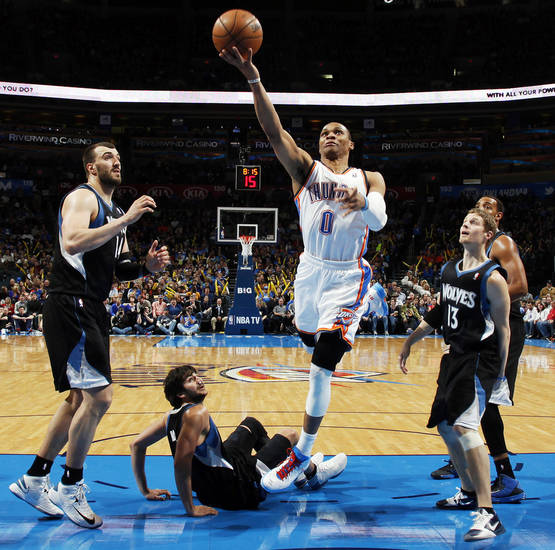 Oklahoma City's Russell Westbrook (0) gets past the Minnesota defense during an NBA basketball game between the Oklahoma City Thunder and Minnesota Timberwolves at Chesapeake Energy Arena in Oklahoma City, Friday, Feb. 22, 2013. Oklahoma City won, 127-111. Photo by Nate Billings, The Oklahoman