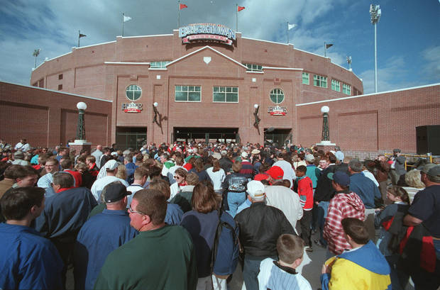 This 1998 photo shows fans lining up to attend the first baseball game at what is now called Chickasaw Bricktown Ballpark, which was paid for by the original MAPS tax. Photo by Doug Hoke, The Oklahoman Archives