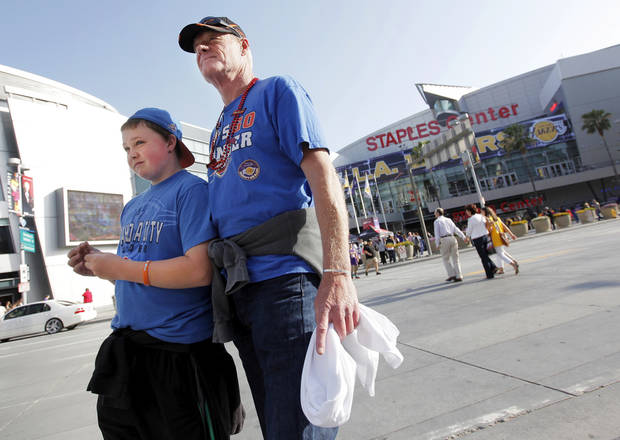 Thunder fans Scott Amis and his son Mason Amis, 12, wait outside the Staples Center before Game 3 in the second round of the NBA basketball playoffs between the L.A. Lakers and the Oklahoma City Thunder at the Staples Center in Los Angeles, Friday, May 18, 2012. The Amis family moved from Oklahoma City to Malibu 14 month ago. Photo by Nate Billings, The Oklahoman