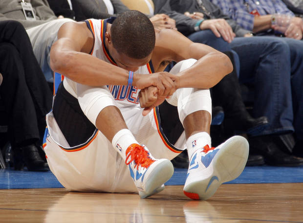 Oklahoma City Thunder's Russell Westbrook (0) reacts after a play during the the NBA basketball game between the Oklahoma City Thunder and the San Antonio Spurs at the Chesapeake Energy Arena in Oklahoma City, Sunday, Jan. 8, 2012. Photo by Sarah Phipps, The Oklahoman