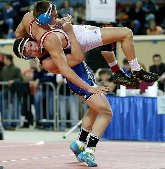 Deer Creek's Cole Pacheco , left, wrestles Collinsville's Zach Abkemeier during the Class 5a 170-pound championship match in the state wrestling championships at the State Fair Arena in Oklahoma City, Saturday, Feb. 23, 2013. Photo by Bryan Terry, The Oklahoman