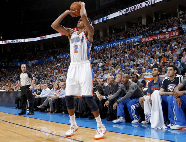 Oklahoma City&#039;s Thabo Sefolosha (2) shoots a three-point basket during an NBA basketball game between the Oklahoma City Thunder and the Toronto Raptors at Chesapeake Energy Arena in Oklahoma City, Tuesday, Nov. 6, 2012.  Tuesday, Nov. 6, 2012. Oklahoma City won 108-88. Photo by Bryan Terry, The Oklahoman