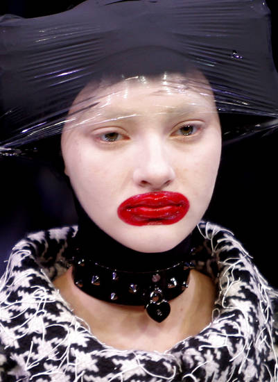 A model wears a creation by British fashion designer Alexander McQueen as part of his Fall-Winter 2009-2010 ready-to-wear collection, Paris, Tuesday, March 10, 2009. (AP Photo/Christophe Ena) ORG XMIT: XCE136