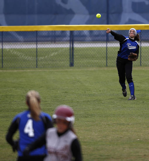 Little Axe's Ally Allen (23) throws a ball from outfield during the 3A OSSAA Championship softball game between Little Axe and Sequoyah at ASA Hall of Fame Stadium in Oklahoma City, Saturday, Oct. 6, 2012.  Photo by Garett Fisbeck, The Oklahoman