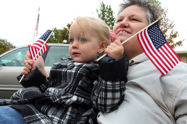 Abby Prewitt and her aunt Diane Scott of Yukon watch the Veterans Day parade in Norman Sunday. PHOTO BY HUGH SCOTT FOR THE OKLAHOMAN ORG XMIT: KOD