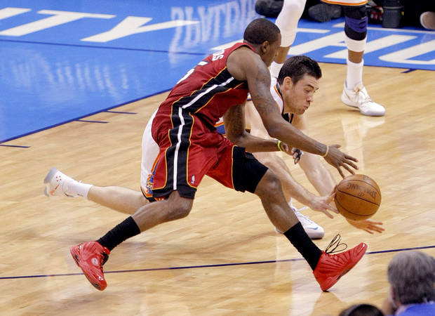 Oklahoma City's Nick Collison (4) fights Miami's Mario Chalmers (15) for a loose ball during Game 1 of the NBA Finals between the Oklahoma City Thunder and the Miami Heat at Chesapeake Energy Arena in Oklahoma City, Tuesday, June 12, 2012. Photo by Sarah Phipps, The Oklahoman