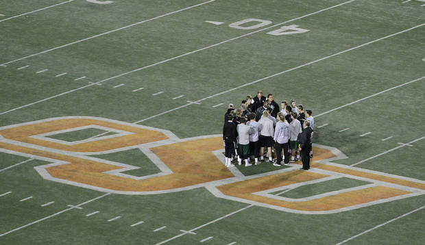 Members of the Norman North football team have a pre-game meeting during the Class 6A Oklahoma state championship football game between Norman North High School and Jenks High School at Boone Pickens Stadium on Friday, Nov. 30, 2012, in Stillwater, Okla.   Photo by Chris Landsberger, The Oklahoman