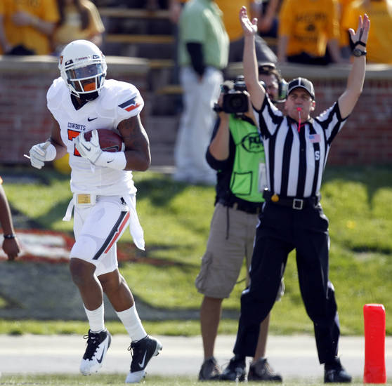 Oklahoma State wide receiver Michael Harrison runs into the end zone after catching a touchdown pass during the first half of an NCAA college football game against Missouri Saturday, Oct. 22, 2011, in Columbia, Mo. (AP Photo/Jeff Roberson)