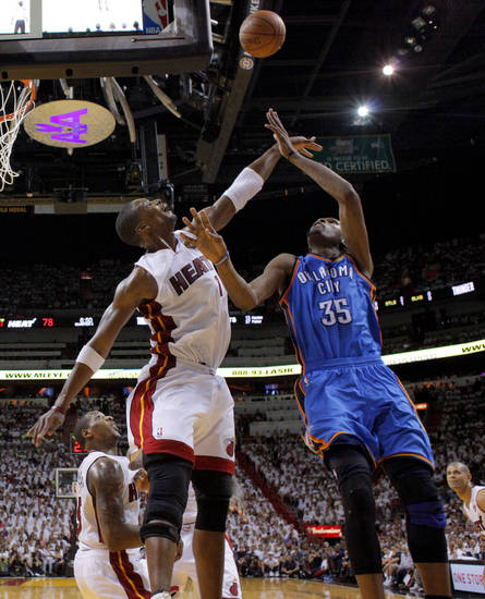 Oklahoma City's Russell Westbrook (0) can't get the ball over Miami's Chris Bosh (1) during Game 3 of the NBA Finals between the Oklahoma City Thunder and the Miami Heat at American Airlines Arena, Sunday, June 17, 2012. Oklahoma City lost 91-85. Photo by Bryan Terry, The Oklahoman