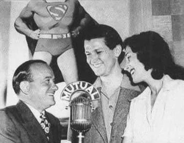 "National (DC) Comics Publisher Harry Donenfeld, left, with Bud Collyer and Joan Alexander of ""The Adventures of Superman"" radio program. Mutual Broadcasting System photo."