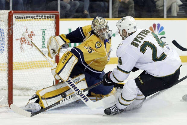 Nashville Predators goalie Pekka Rinne (35), of Finland, blocks a shot by Dallas Stars left wing Eric Nystrom (24) in the first period of an NHL hockey game on Monday, Feb. 25, 2013, in Nashville, Tenn. (AP Photo/Mark Humphrey)