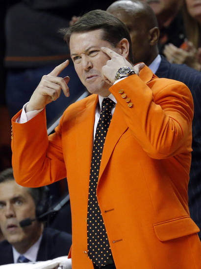 OSU head coat Travis Ford coaches during the Bedlam men's college basketball game between the Oklahoma State University Cowboys and the University of Oklahoma Sooners at Gallagher-Iba Arena in Stillwater, Okla., Saturday, Feb. 16, 2013. Photo by Sarah Phipps, The Oklahoman