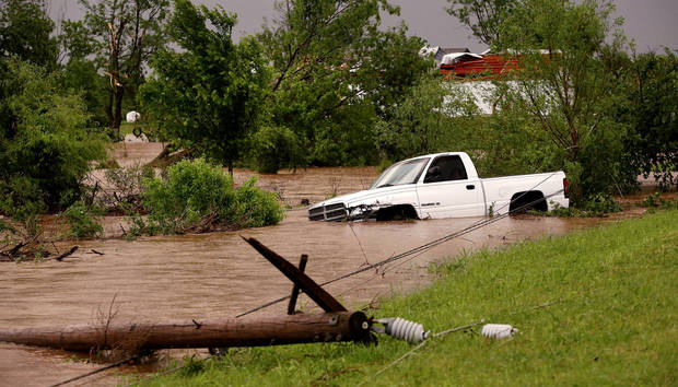 Downed power lines and flooding along State Highway 66, east of US 81. May 31, 2013     Photo  by Jim Beckel, The Oklahoman.