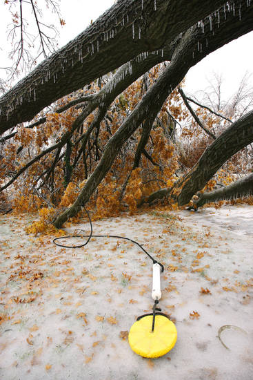 WINTER / COLD / WEATHER / ICE STORM / DAMAGE / AFTERMATH: A swing lays on the ground after the tree it was attached to fell in the 400 block of NW 38 in the Crown Heights housing addition in Oklahoma City Monday, Dec. 10, 2007. By Paul B. Southerland, The Oklahoman ORG XMIT: KOD