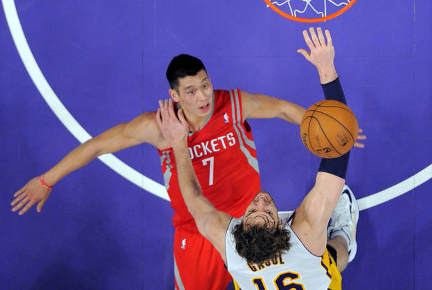 Los Angeles Lakers forward Pau Gasol, below, of Spain, puts up a shot as Houston Rockets guard Jeremy Lin defends during the first half of their NBA basketball game, Sunday, Nov. 18, 2012, in Los Angeles. (AP Photo/Mark J. Terrill)