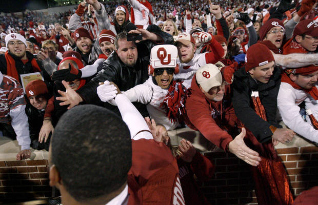 Fans celebrate with R.J. Washington after the college football game between the University of Oklahoma Sooners and Texas Tech University at Gaylord Family -- Oklahoma Memorial Stadium in Norman, Okla., Saturday, Nov. 22, 2008. BY BRYAN TERRY, THE OKLAHOMAN