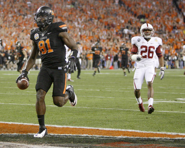 Oklahoma State's Justin Blackmon (81) scores a touchdown in  front of Delano Howell (26) during the Fiesta Bowl between the Oklahoma State University Cowboys (OSU) and the Stanford Cardinal at the University of Phoenix Stadium in Glendale, Ariz., Monday, Jan. 2, 2012. Photo by Bryan Terry, The Oklahoman